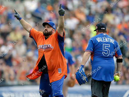 Kevin James, Gary Valentine Actor/comedian Kevin James, left, gestures after a play at second base in the All-Star Legends & Celebrity Softball Game, in New York. James' brother and fellow comedian Gary Valentine, right, looks on