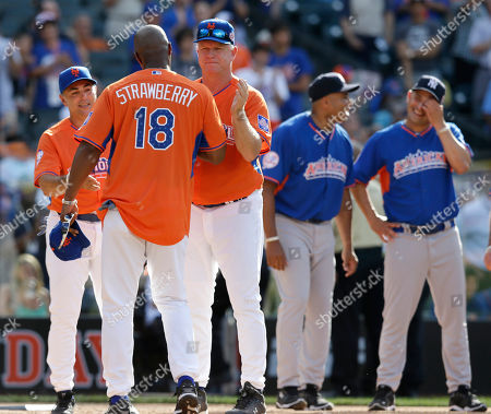 Darryl Strawberry, Boomer Esiason Former New York Mets outfielder Darryl Strawberry is greeted by radio personality Boomer Esiason as John Franco, far left, bernie Williams, second from right, and Craig Carton look on at the All Star Legends & Celebrity Softball Game on in New York
