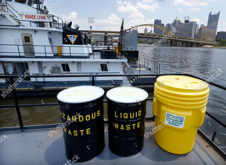 "Containment barrels are seen on the stern of the new ""Alice Jean"" towboat moored beside it's sister boat, the ""Renee Lynn"" along the Allegheny River in Pittsburgh. The Campbell Transportation Company christened their new towboats and their portable drydock on Tuesday, June 25"