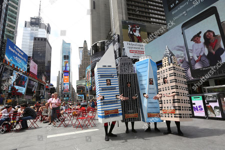 The Broadscrapers, a barbershop quartet sing a medley of New York-inspired songs, while dressed as landmark New York buildings, in New York's Times Square, . The promotional event sponsored by Broad Financial featured, from left, Evan Shyer as the Citigroup Center, Brad Heikes as the Empire State Building, Adam Bock as the Freedom Tower and Stephen Tyler Davis as the Chrysler Building
