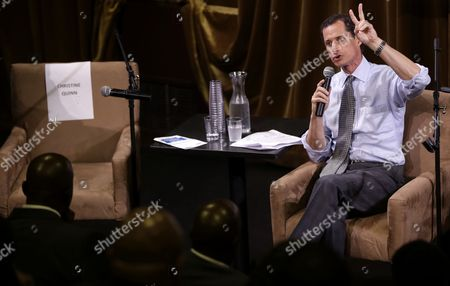 John Liu Democratic mayoral hopeful Anthony Weiner speaks while seated next to a seat bearing Christine Quinn's name at a candidate forum in New York, . Quinn did not participate in the forum