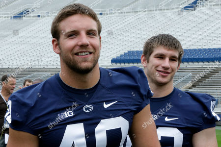 Mike Hull, Glenn Carson Penn State linebackers Glenn Carson (40) and Mike Hull wait for a group photo during the NCAA college football team's media day in State College, Pa