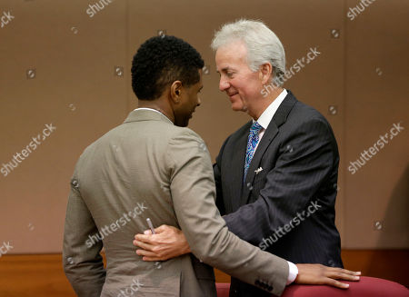 Usher, John Mayoue R&B singer Usher, left, is embraced by his attorney John Mayoue after a judge dismissed an emergency request by Usher's ex-wife Tameka Foster Raymond, seeking temporary custody of their two children, in Atlanta. Raymond had requested the hearing earlier this week after their 5-year-old son got caught in a pool drain while in the care of the Grammy winner's aunt. After a hearing in which both Usher and Raymond took the stand, Fulton County Superior Court Judge John Goger dismissed her request for temporary primary custody and decision-making authority