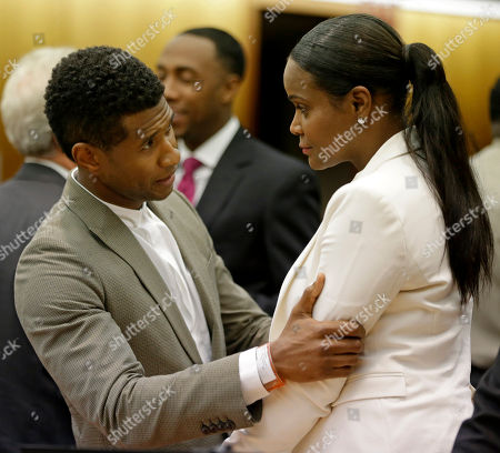 Usher, Tameka Foster Raymond R&B singer Usher, left, embraces ex-wife Tameka Foster Raymond, after a judge dismissed an emergency request by Raymond seeking temporary custody of their two children, in Atlanta. Raymond had requested the hearing earlier this week after their 5-year-old son got caught in a pool drain while in the care of the Grammy winner's aunt. After a hearing in which both Usher and Raymond took the stand, Fulton County Superior Court Judge John Goger dismissed her request for temporary primary custody and decision-making authority
