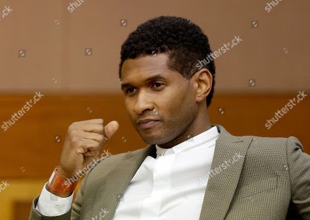 Usher R&B singer Usher sits through a child custody hearing, in Atlanta. A judge in Atlanta is set to hear arguments in the child custody battle between Usher and his ex-wife. Tameka Foster Raymond requested the hearing earlier this week after the former couple's son got caught in a pool drain while in the care of the Grammy winner's aunt