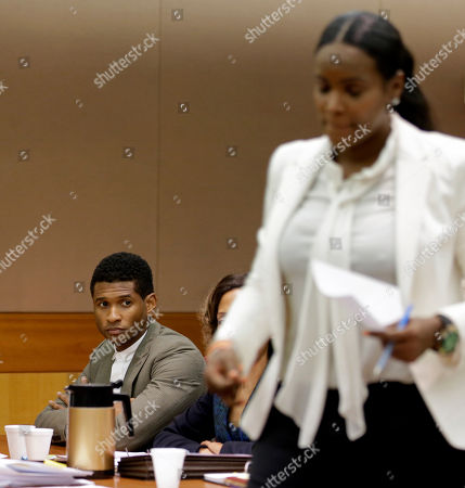 Usher, Tameka Foster Raymond R&B singer Usher, left, looks on as ex-wife Tameka Foster Raymond takes the witness stand during a child custody hearing, in Atlanta. Foster Raymond requested the hearing earlier this week after the former couple's son got caught in a pool drain while in the care of the Grammy winner's aunt