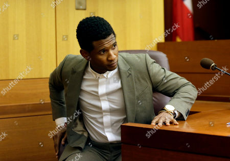 Usher R&B singer Usher steps down from the witness stand during a child custody hearing with ex-wife Tameka Foster Raymond, in Atlanta. Raymond had requested the hearing earlier this week after their 5-year-old son got caught in a pool drain while in the care of the Grammy winner's aunt. After a hearing in which both Usher and Raymond took the stand, Fulton County Superior Court Judge John Goger dismissed her request for temporary primary custody and decision-making authority