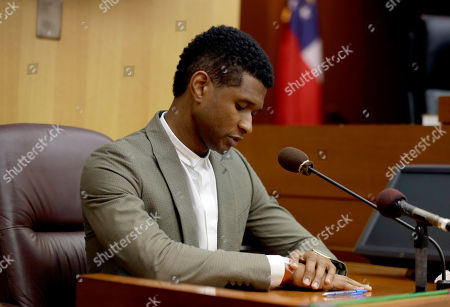 Usher R&B singer Usher speaks from the witness stand during a child custody hearing with ex-wife Tameka Foster Raymond, in Atlanta. Raymond had requested the hearing earlier this week after their 5-year-old son got caught in a pool drain while in the care of the Grammy winner's aunt. After a hearing in which both Usher and Raymond took the stand, Fulton County Superior Court Judge John Goger dismissed her request for temporary primary custody and decision-making authority