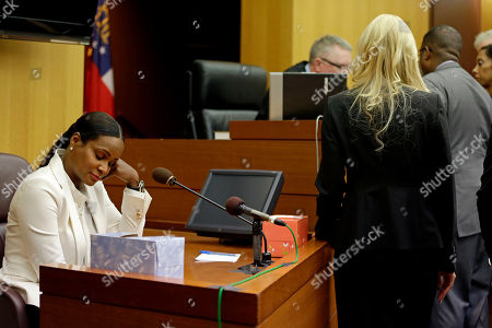Tameka Foster Raymond Tameka Foster Raymond sits in the witness stand as attorneys approach the bench during a child custody hearing with ex-husband, R&B singer Usher, in Atlanta. A judge in Atlanta is set to hear arguments in the child custody battle between Usher and his ex-wife. Tameka Foster Raymond requested the hearing earlier this week after the former couple's son got caught in a pool drain while in the care of the Grammy winner's aunt