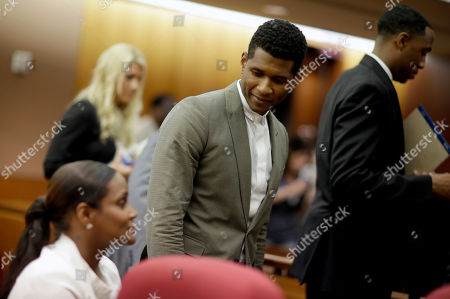 Usher, Tameka Foster Raymond R&B singer Usher, center, talks with ex-wife Tameka Foster Raymond, left, after a judge dismissed an emergency request by Raymond seeking temporary custody of their two children, in Atlanta. Raymond had requested the hearing earlier this week after their 5-year-old son got caught in a pool drain while in the care of the Grammy winner's aunt. After a hearing in which both Usher and Raymond took the stand, Fulton County Superior Court Judge John Goger dismissed her request for temporary primary custody and decision-making authority