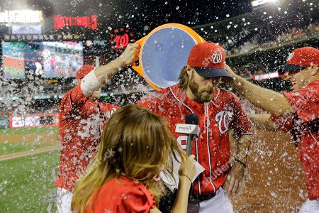 Jayson Werth, Julie Alexandria, Craig Stammen, Bryce Harper Washington Nationals' Jayson Werth, center, is doused by Bryce Harper, left, and Craig Stammen, right, during a post game interview with MASN's Julie Alexandria, second from left, after a baseball game against the Philadelphia Phillies at Nationals Park, in Washington. Werth scored three runs in the game and the Nationals won 8-5