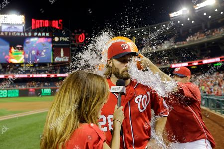 Jayson Werth, Julie Alexandria, Craig Stammen Washington Nationals' Jayson Werth, center, is doused by Bryce Harper, not seen, and Craig Stammen, right, during a post game interview with MASN's Julie Alexandria, left, after a baseball game against the Philadelphia Phillies at Nationals Park, in Washington. Werth scored three runs in the game and the Nationals won 8-5