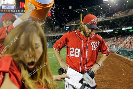 Stock Picture of Jayson Werth, Julie Alexandria, Bryce Harper Washington Nationals' Jayson Werth, center, is doused by Bryce Harper, left, and Craig Stammen, not seen, during a post game interview with MASN's Julie Alexandria, second from left, after a baseball game against the Philadelphia Phillies at Nationals Park, in Washington. Werth scored three runs in the game and the Nationals won 8-5