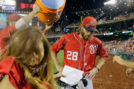 Stock Photo of Jayson Werth, Julie Alexandria, Craig Stammen, Bryce Harper Washington Nationals' Jayson Werth, center, is doused by Bryce Harper, left, and Craig Stammen, right, during a post game interview with MASN's Julie Alexandria, second from left, after a baseball game against the Philadelphia Phillies at Nationals Park, in Washington. Werth scored three runs in the game and the Nationals won 8-5