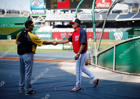 Jeff Branson, Davey Johnson Pittsburgh Pirates coach Jeff Branson, left, shakes hands with Washington Nationals manager Davey Johnson (5), right, before a baseball game at Nationals Park, in Washington