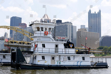 "Alice Jean The new towboat ""Alice Jean"" moves up the Allegheny River with the Pittsburgh skyline behind it on the way to be moored along the north shore, in Pittsburgh. The Campbell Transportation Company says it will christen the newly built state-of-the-art towboat and its sister boat the Renee Lynn and a giant portable drydock on Tuesday, June 25"