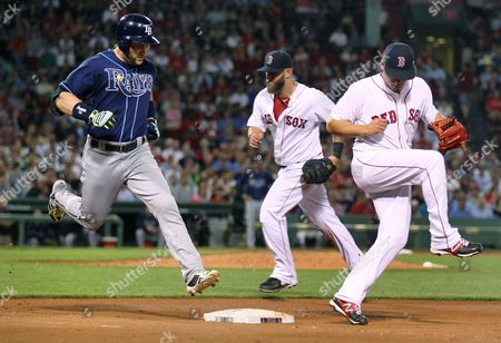 Jose De La Torre, Luke Scott, Mike Napoli Boston Red Sox relief pitcher Jose De La Torre, right, steps away after covering a ground out to first by Tampa Bay Rays' Luke Scott, left, during the eighth inning of a baseball game at Fenway Park, in Boston. At center is Boston Red Sox first baseman Mike Napoli, who fielded the ball