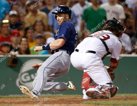 Luke Scott, Jarrod Saltalamacchia Tampa Bay Rays designated hitter Luke Scott slides into homeplate as Boston Red Sox catcher Jarrod Saltalamacchia takes in a late throw as he scores on a single by James Loney during the eighth inning of a baseball game at Fenway Park in Boston