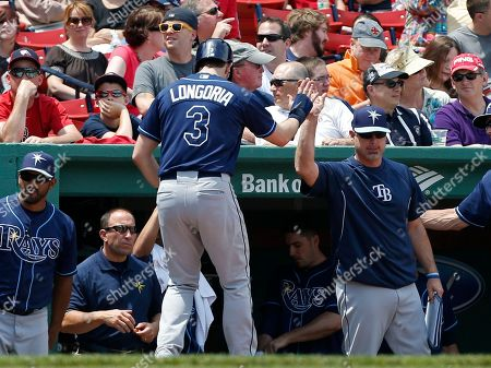 Evan Longoria Tampa Bay Rays' Evan Longoria (3) celebrates after scoring on double by teammate Luke Scott in the second inning of the first game of a baseball doubleheader against the Boston Red Sox in Boston