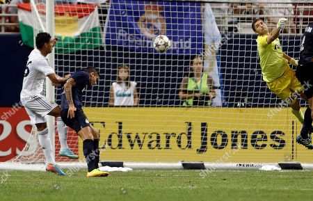 Casemiro, Ricardo Alvarez, Juan Pablo Carrizo A ball is deflected off Inter Milan's Ricardo Alvarez, center, and past Inter Milan goalkeeper Juan Pablo Carrizo, right, and into their goal as Real Madrid's Casemiro, left, watches during the second half of an exhibition soccer match, at the Edward Jones Dome in St. Louis
