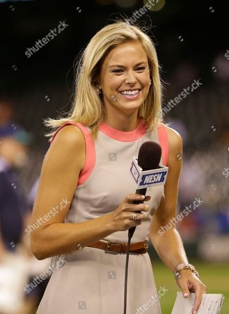 Stock Picture of Heidi Watney NESN Boston Red Sox reporter Jamie Erdahl waits to conduct an interview following a baseball game between the Red Sox and the Seattle Mariners, in Seattle