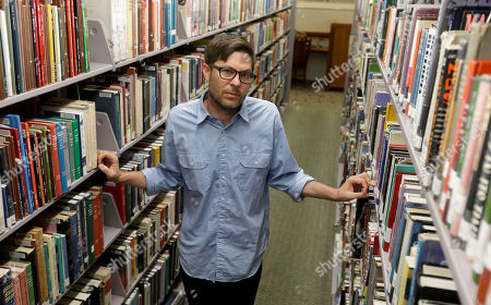 Stock Photo of Josh Kun Josh Kun, the curator who organized a collection of music themed around Loa Angeles poses for a picture at the main branch of the Los Angeles Public Library in Los Angeles. Kun, a USC professor and some of his students, have digitized them, put a cross-section of nearly 200 into a colorful coffee-table book and even persuaded the LA fusion group Ozomatli to perform many at a concert later this summer