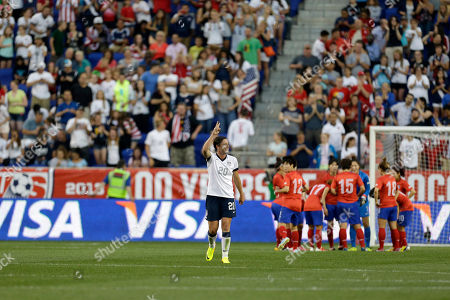 Abby Wambach United States' Abby Wambach, left, reacts after scoring a goal against South Korea, during the first half of an international friendly soccer match at Red Bull Arena, in Harrison, N.J. With the goal, Wambach tied former U.S. player Mia Hamm for the world's all time leading scorer