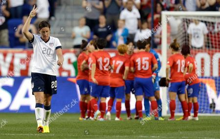 Abby Wambach United States' Abby Wambach, left, reacts after scoring a goal against South Korea during the first half of an international friendly soccer match at Red Bull Arena, in Harrison, N.J. With the goal Wambach ties for most scored goals with former US player Mia Hamm