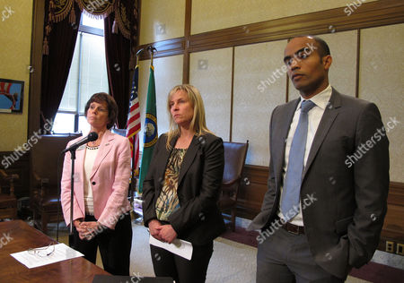 From left to right, Washington Gov. Jay Inslee's Chief of Staff Mary Alice Heuschel, Julie Murray from the Office of Financial Management, and Inslee's general counsel, Nicholas Brown, listen to a question from the media about contingency plans for a potential government shutdown,, in Olympia, Wash. On Monday, thousands of state employees will begin receiving temporary layoff notices that would take effect July 1 if a state budget is not in place by June 30