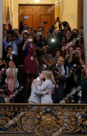 Kris Perry, foreground left, kisses Sandy Stier as they are married at City Hall in San Francisco, . Stier and Perry were married Friday, June 28, 2013, after a federal appeals court on Friday cleared the way for the state of California to immediately resume issuing marriage licenses to same-sex couples after a 4 1/2-year freeze