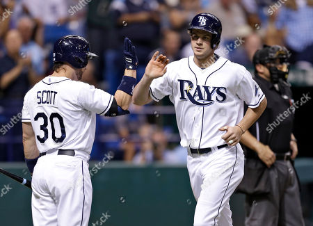 Wil Myers, Luke Scott Tampa Bay Rays' Wil Myers, right, high fives on-deck batter Luke Scott after his fifth-inning home run off Detroit Tigers starting pitcher Max Scherzer during a baseball game, in St. Petersburg, Fla