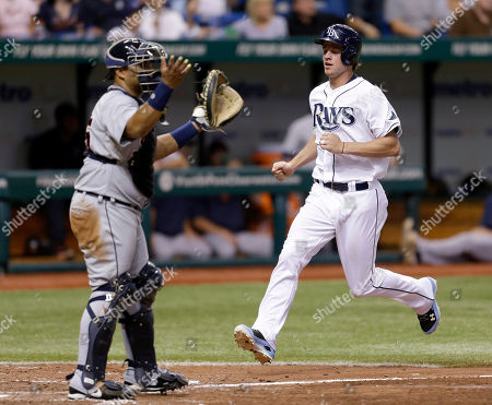Wil Myers, Brayan Pena Tampa Bay Rays' Wil Myers scores in front of Detroit Tigers catcher Brayan Pena on a seventh inning RBI double by Luke Scott off Detroit Tigers starting pitcher Max Scherzer during a baseball game, in St. Petersburg, Fla