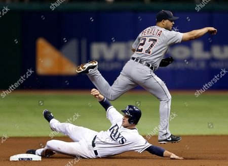 Wil Myers, Jhonny Peralta Detroit Tigers shortstop Jhonny Peralta leaps over Tampa Bay Rays' Wil Myers after forcing him at second base and relaying the throw to first base in time to get Rays' Luke Scott completing a fourth-inning double play during a baseball game, in St. Petersburg, Fla