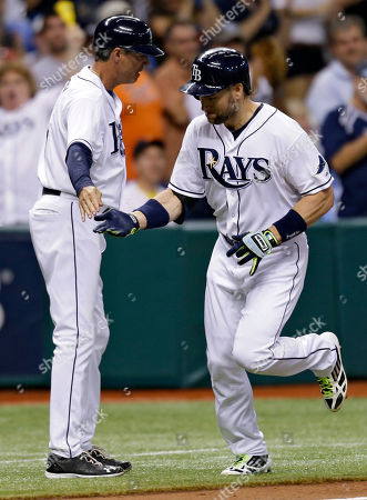 Luke Scott, Tom Foley Tampa Bay Rays' Luke Scott, right, high-fives third base coach Tom Foley after hitting an eighth inning home run off Detroit Tigers starting pitcher Justin Verlander during a baseball game, in St. Petersburg, Fla. The Rays won 4-3 in 10 innings