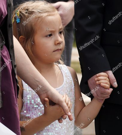 Stock Picture of Cory Mathis Six-year-old transgender girl Coy Mathis holds hands with her attorney Michael Silverman and her mother Kathryn Mathis at a news conference at the Capitol in Denver on . The Colorado Civil Rights Division has ruled in favor of Coy Mathis, whose school had barred her from using the girls' bathroom at her elementary school because she is transgender