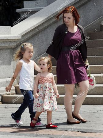 Stock Image of Coy Mathis, Auri Mathis, Kathryn Mathis Six-year-old transgender girl Coy Mathis, left, her sister Auri and mother Kathryn Mathis walk to a news conference at the Capitol in Denver on . The Colorado Civil Rights Division has ruled in favor of six-year-old Coy Mathis, whose school had barred her from using the girls' bathroom at her elementary school because she is transgender