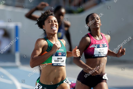 Queen Harrison, Kellie Wells Queen Harrison, left, reacts in front of Kellie Wells, right, as she wins her heat in the senior women's 100-meter hurdles at the U.S. Championships athletics meet, in Des Moines, Iowa