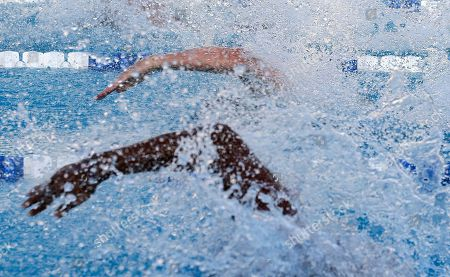 Derek Toomey, Cullen Jones Derek Toomey, top, and Cullen Jones compete during the men's 50 meter freestyle final at the U.S. Open Swimming Championships, in Irvine, Calif