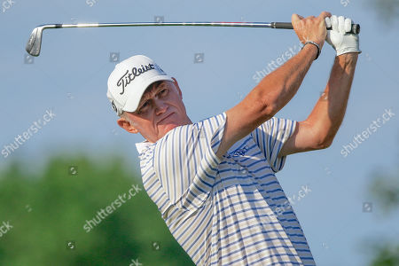 Roger Chapman of England tees off on the tenth hole, in the second round of the U.S. Senior Open golf tournament in Omaha, Neb
