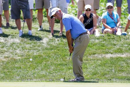 Corey Pavin Corey Pavin chips the ball onto the fourth hole green, in the final round of the U.S. Senior Open golf tournament in Omaha, Neb