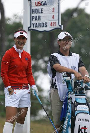 Ha Neul Kim Ha Neul Kim, of South Korea, talks with her caddie Hyung Woo Joo before hitting a tee shot on the second hole during the second round of the U.S. Women's Open golf tournament at the Sebonack Golf Club, in Southampton, N.Y