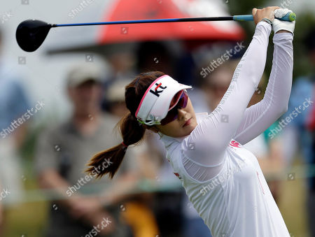 Stock Image of Ha-Neul Kim Ha-Neul Kim, of South Korea, tees off on the first hole during the third round of the U.S. Women's Open golf tournament at the Sebonack Golf Club, in Southampton, N.Y