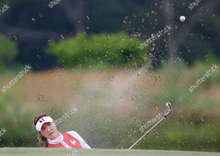 Ha-Neul Kim Ha-Neul Kim of South Korea hits out of a bunker near the seventh green during the second round at the U.S. Women's Open golf tournament at Sebonack Golf Club in Southampton, N.Y
