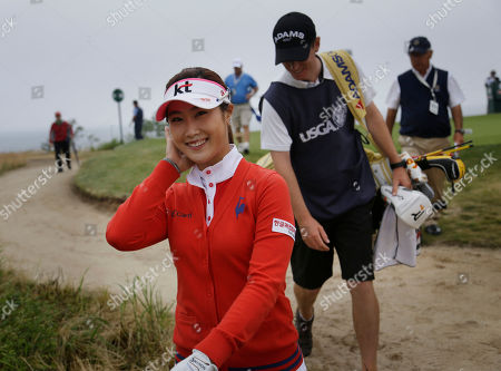 Ha-Neul Kim Ha-Neul Kim of South Korea walks to the fairway of the first hole after teeing off during the second round at the U.S. Women's Open golf tournament at Sebonack Golf Club in Southampton, N.Y
