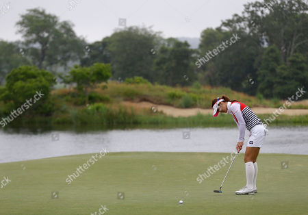 Ha-Neul Kim Ha-Neul Kim of South Korea sinks a putt on the seventh green during the second round at the U.S. Women's Open golf tournament at Sebonack Golf Club in Southampton, N.Y