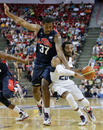 Utah Jazz's Derrick Favors (37) reaches in on Memphis Grizzlies' Mike Conley (20) in the fourth quarter of the USA Basketball Showcase game, in Las Vegas. The White team beat the Blue team 128-106
