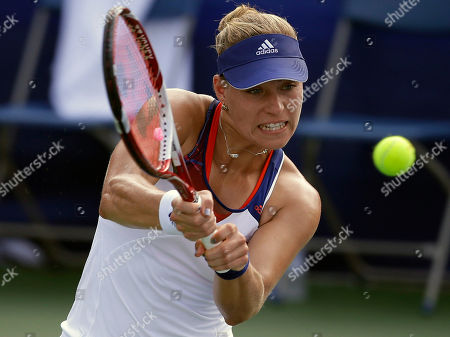 Angelique Kerber Angelique Kerber, from Germany, returns the ball during her match against Melanie Oudin at the Citi Open tennis tournament in Washington