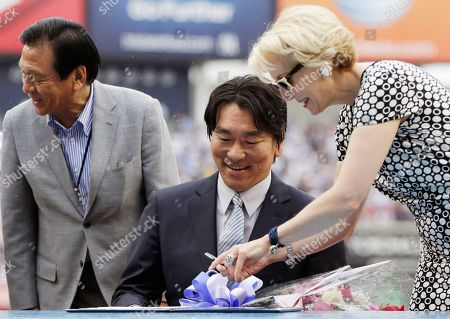 Masao Matsui, Hideki Matsui, Jean Afterman New York Yankees Assistant General Manager Jean Afterman, right, shows 2009 World Series MVP Hideki Matsui, who wore the number 55 as a member of the New York Yankees, where to sign his retirement papers during Matsui's official retirement ceremony before the Yankees 55th baseball game of the year, in New York. Matsui's father Masao is at left