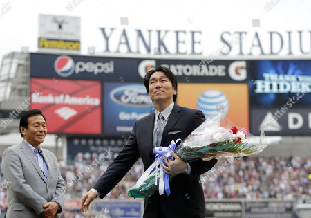 Masao Matsui, Hideki Matsui Masao Matsui, left, watches his son, 2009 World Series MVP Hideki Matsui, who wore the number 55 as a member of the New York Yankees, as fans honor Matsui prior to his official retirement ceremony before the Yankees 55th baseball game of the year, in New York