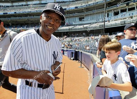 Mickey Rivers Former New York Yankees player Mickey Rivers smiles for a photographer as he signs autographs at the Yankees 67th annual Old Timers Day baseball game, in New York